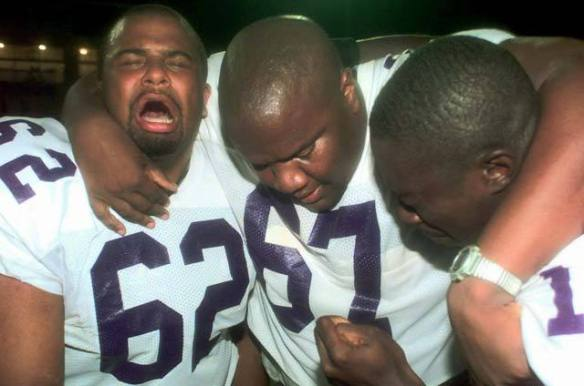 Photo by Jerry Laizure: Prairie View A&M football players crying after breaking a record 80-game losing streak, defeating Langston State 14-12, Oklahoma City, 1998.