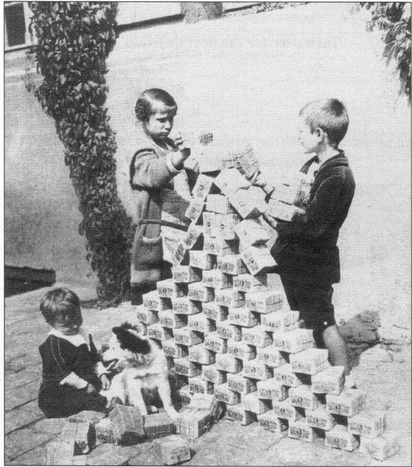 German Children Playing with Worthless Paper Reichsmarks, 1923