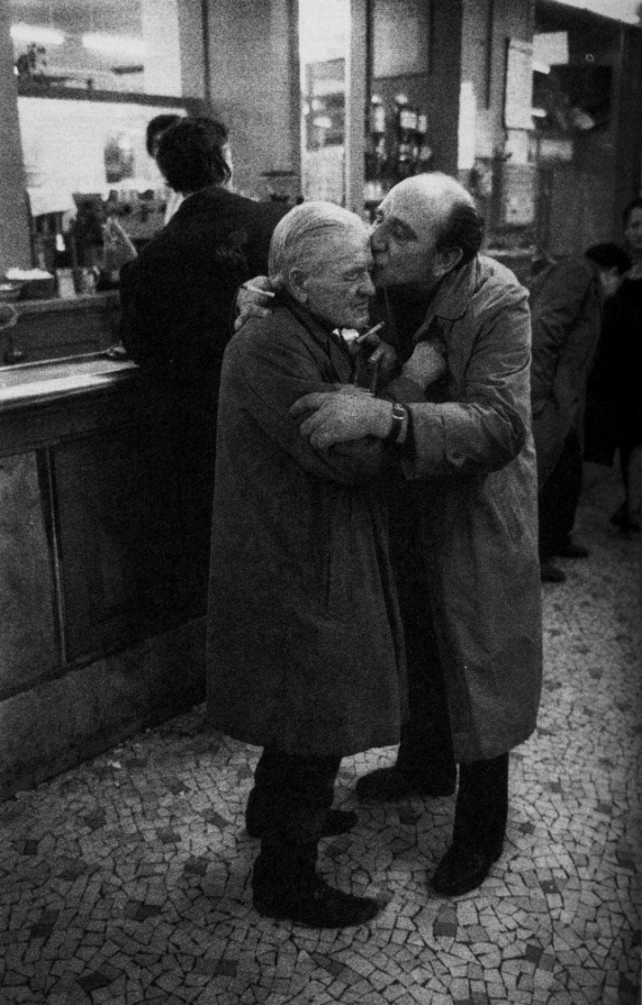 Two Men Kissing in a Paris Café