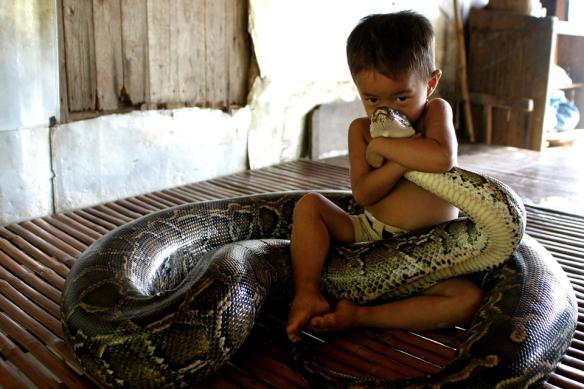 Boy hugging snake