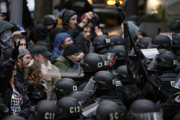 A woman is blasted with pepper spray during Occupy protests in Portland, Oregon, USA, 17 November 2011
