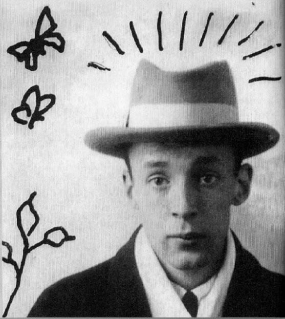 Photo: Vladimir Nabokov with butterfly doodles by the author (1920s)
