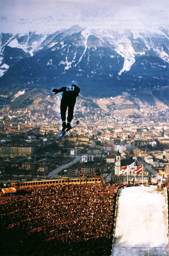 Photo by Ralph Crane: Ski-jumper over Bergisel Stadium, Innsbruck Olympics, Austria, 1964